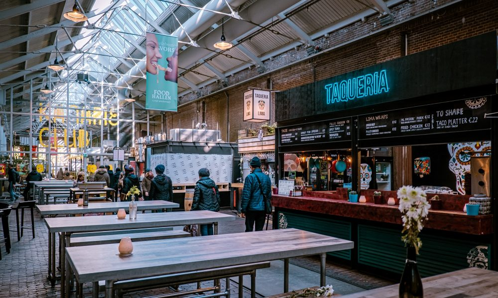 AMSTERDAM,NETHERLANDS- NOVEMBER,2019:Popular food court Foodhallen in center of Amsterdam city.Famous fastfood kitchen in tourist district.Taste exotic dishes Amsterdam street food